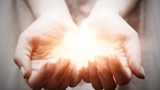 28047479 - the light in young woman hands in cupped shape. concepts of sharing, giving, offering, taking care, protection